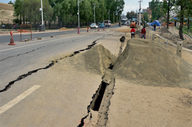 Cracked roads in Nepal after the earthquake. — Photo by Ahmed Al Saidy