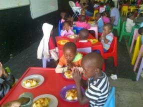 Kids at Thuthuzela praying before meal